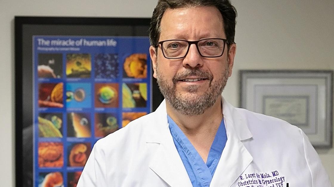 Dr. Loret de Mola Smiling in the IVF Office